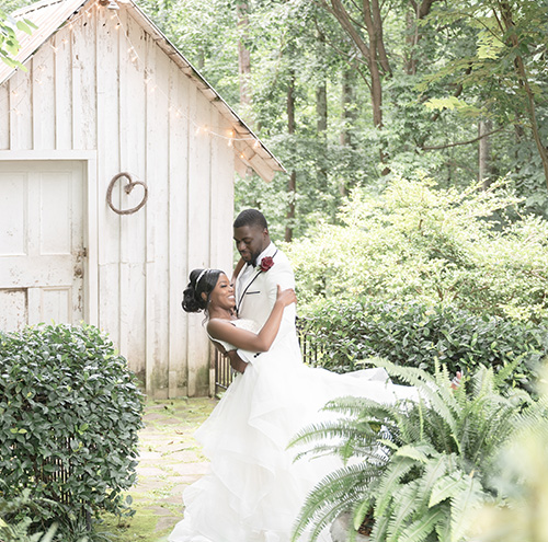 Bride and groom in front of shack